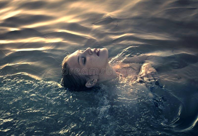 Woman in the sea stock photo
