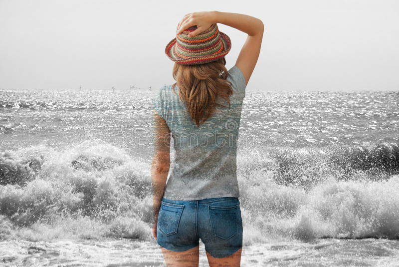 Woman and the sea. Double exposure picture of a young woman and the sea stock photography