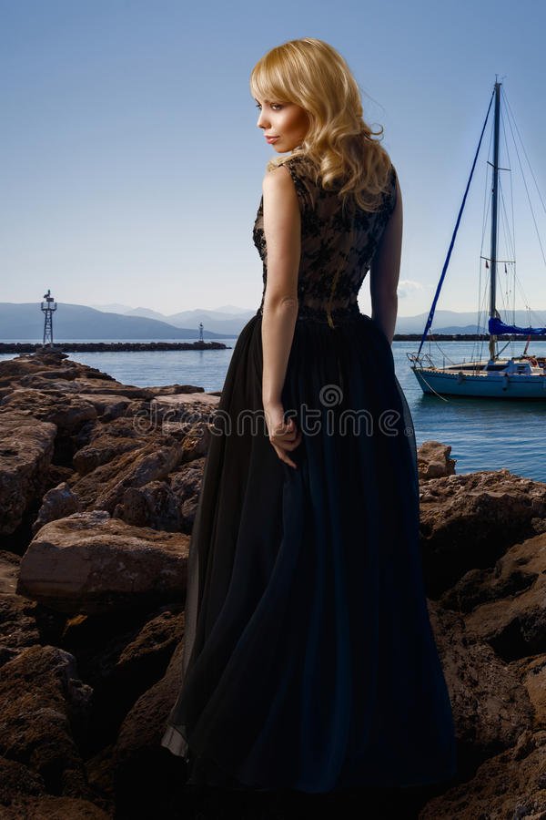 Woman and the sea. Fashion portrait of woman against seascape royalty free stock photos