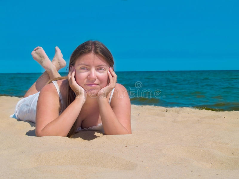 Woman by sea shore stock photography