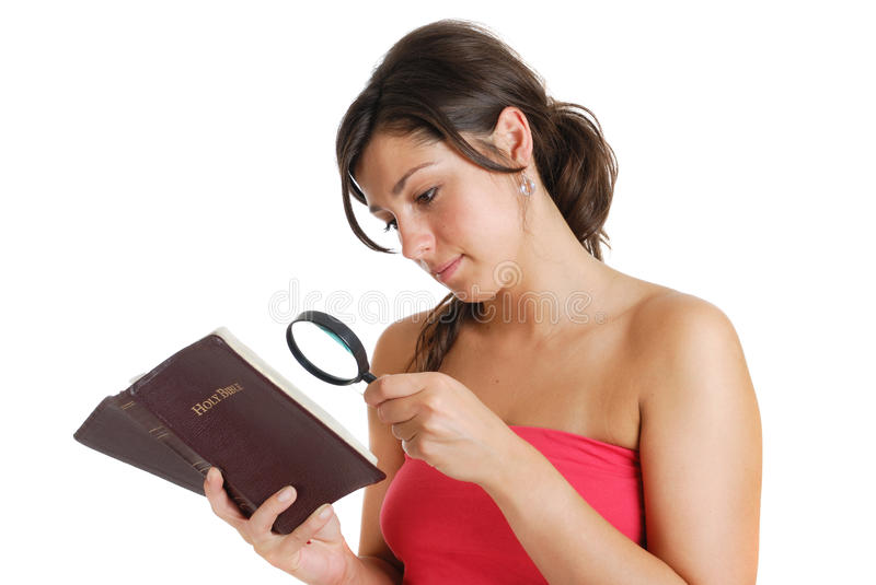 Woman searching the bible concept royalty free stock photography