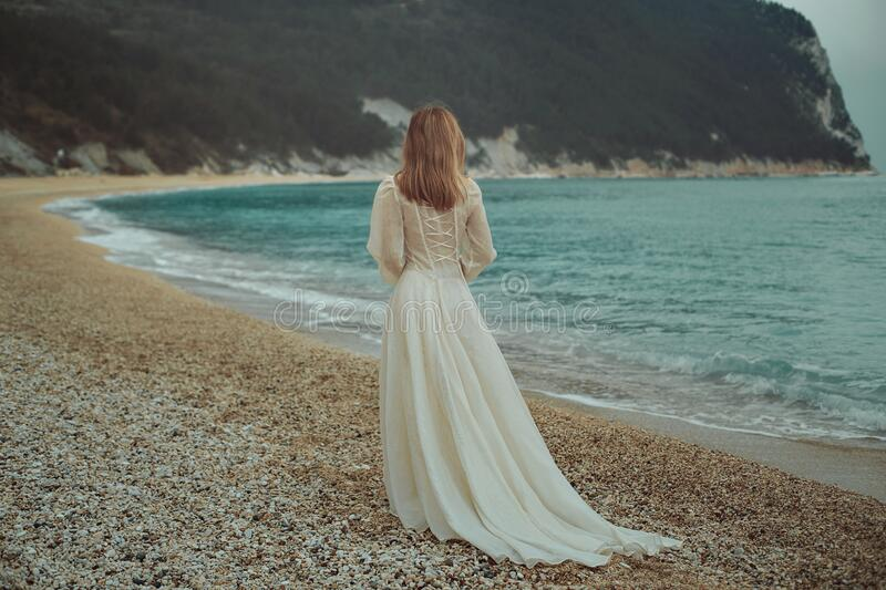 Woman on the seaside stock images