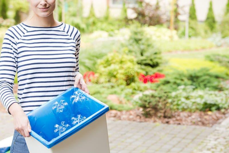 Woman segregating garbage royalty free stock photo