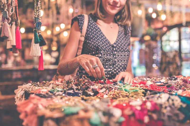 Woman Selecting Beaded Jewelry royalty free stock images