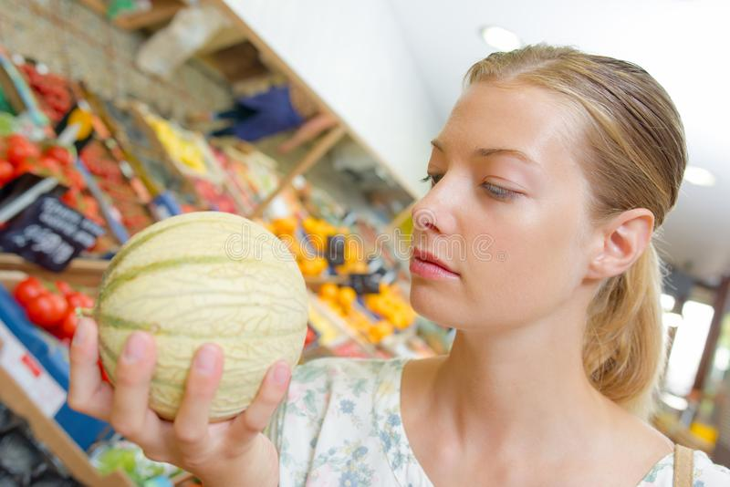 Woman selecting melon royalty free stock image