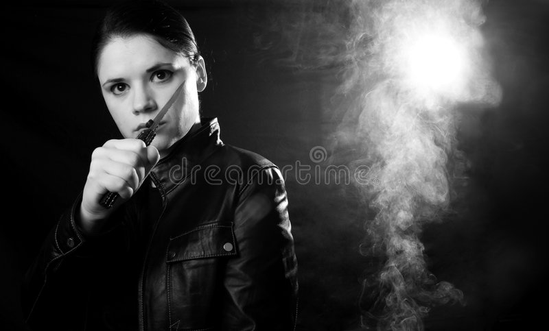 Woman self defense. Woman in self defense in a dark smokey place stock photography
