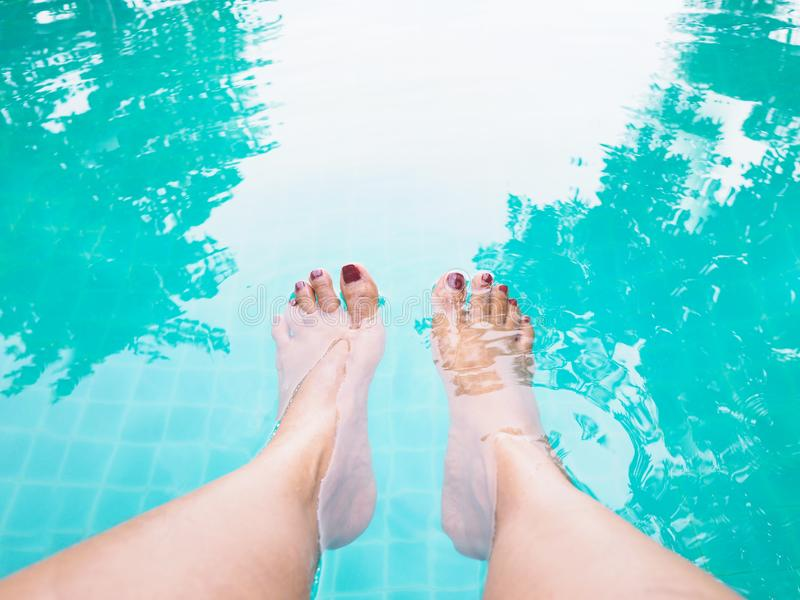 Woman selfie barefoot in the water at swimming pool royalty free stock image