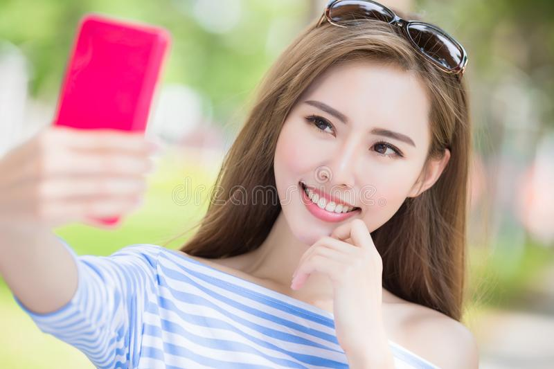 Woman selfie happily. Beauty woman selfie happily in the park royalty free stock photography