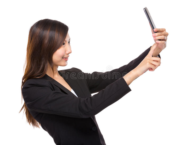 Woman selfie with mobile. Asian woman isolated on white stock photography