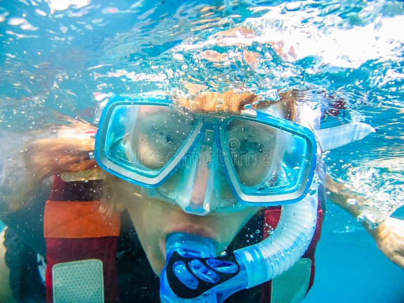 Underwater selfie. Woman having fun and swimming underwater taking a selfie royalty free stock photography