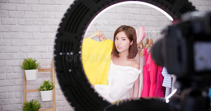 Woman sell clothes in livestreaming stock images