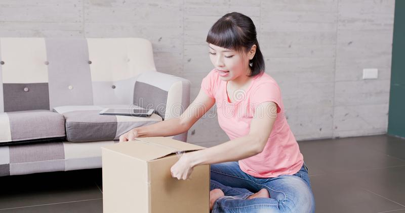 Woman sellers package things. Woman sellers sit on the floor and package things,asia royalty free stock images