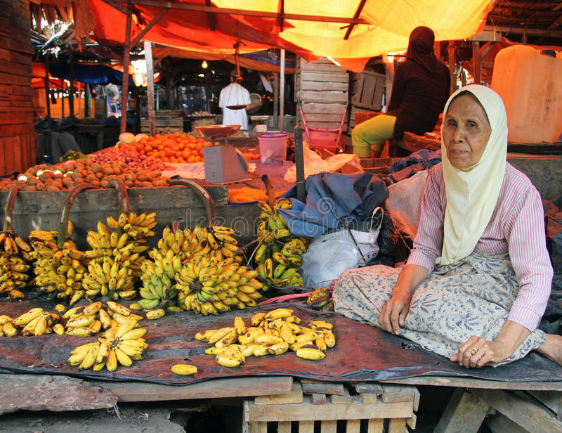 WOMAN SELLING BANANAS IN INDONESIA royalty free stock photo