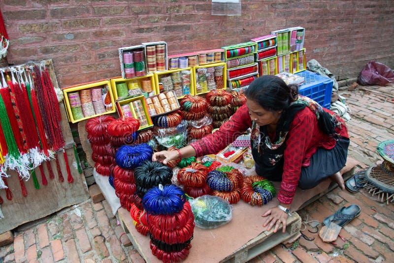 Woman Selling Bangles royalty free stock image