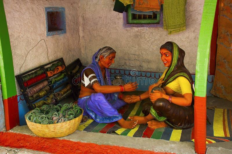 Woman selling bangles, sculpture museum, Kaneri Math, Kolhapur, Maharashtra royalty free stock photo