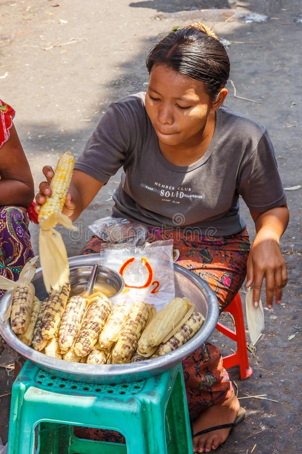 A woman selling corn royalty free stock image