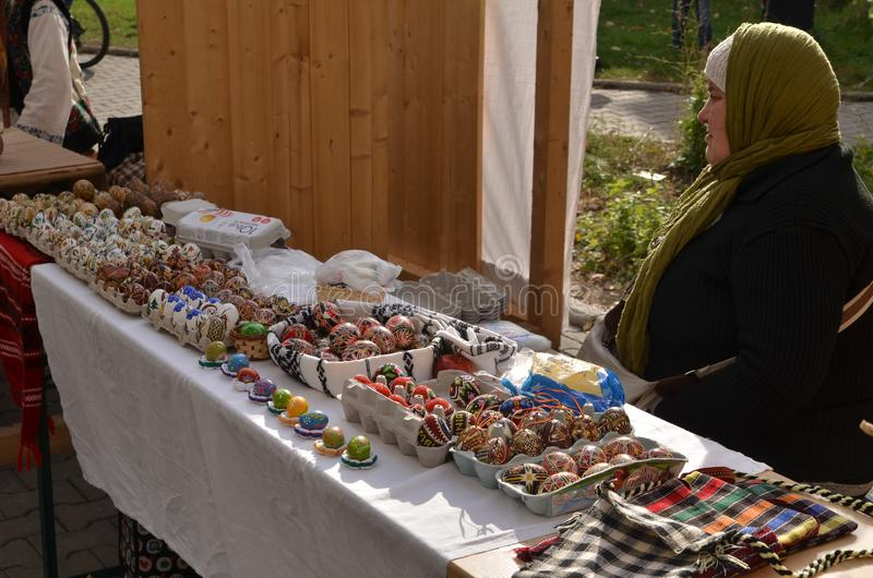 Woman selling Easter eggs stock images