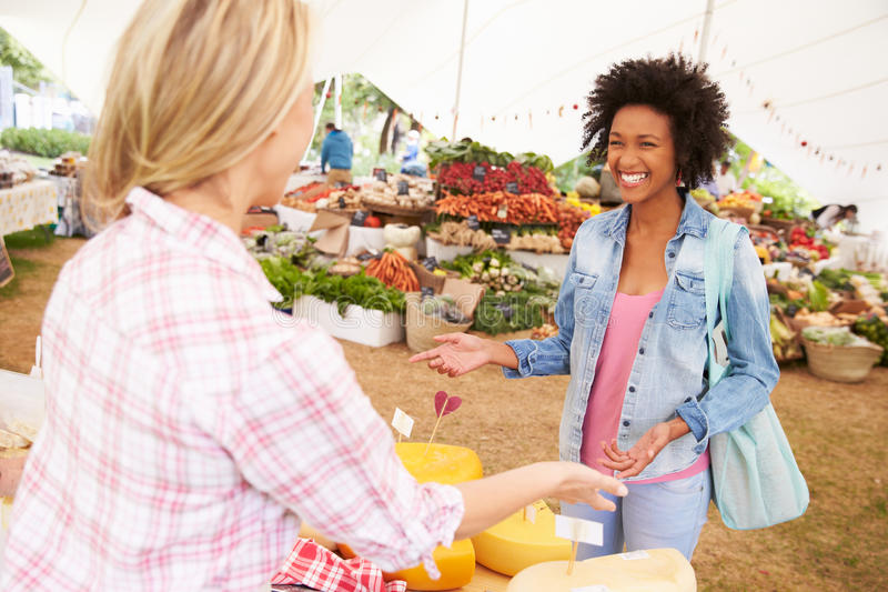 Woman Selling Fresh Cheese At Farmers Food Market stock images