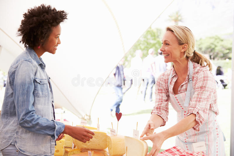 Woman Selling Fresh Cheese At Farmers Food Market royalty free stock photos