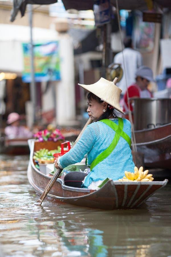 Woman Selling fruirs at floating market royalty free stock image