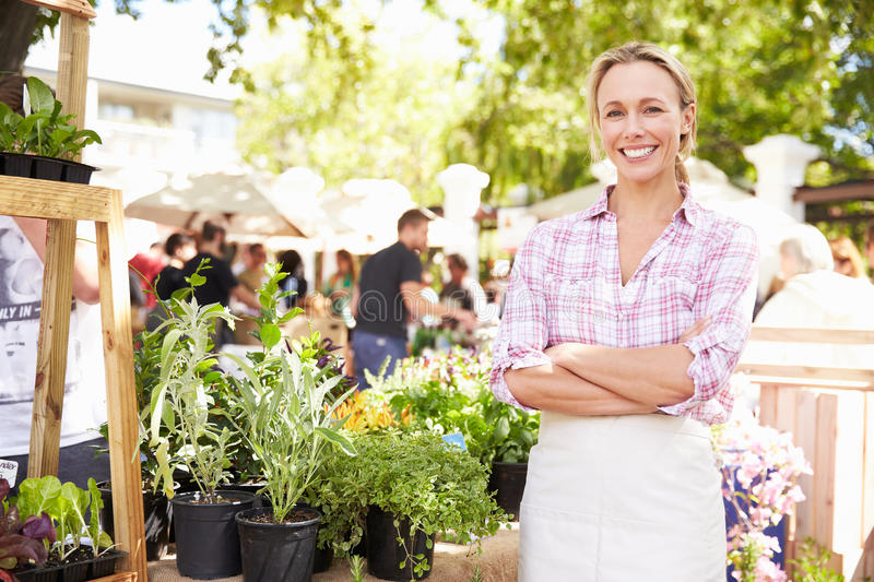 Woman Selling Herbs And Plants At Farmers Food Market royalty free stock photos