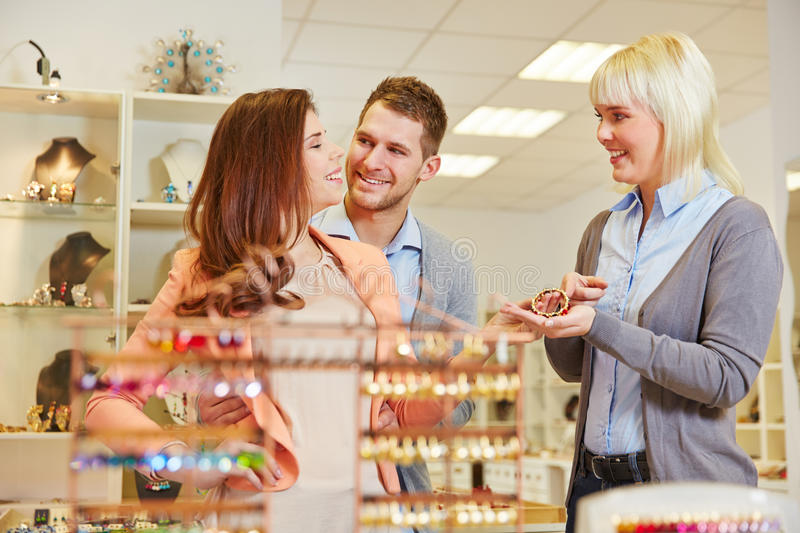 Woman selling jewelry in store stock photo