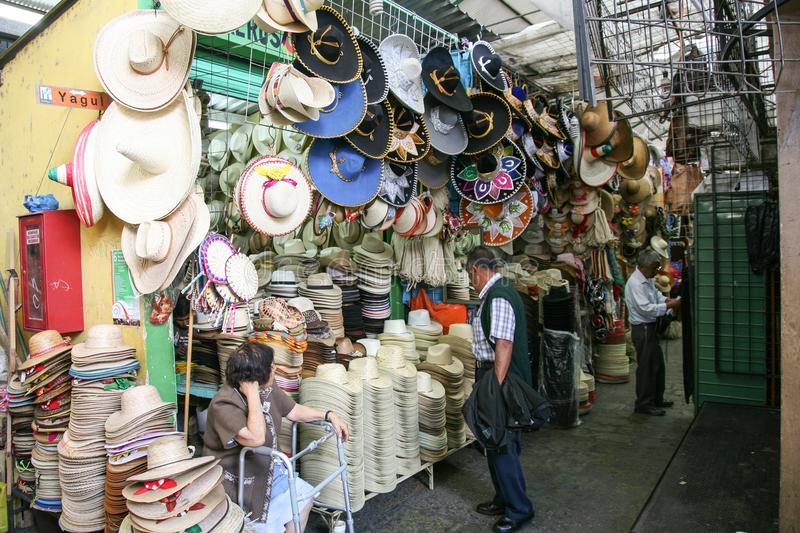 Woman selling large variety of mexican traditional hats and sombreros royalty free stock image