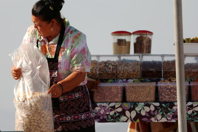 Woman selling peanuts stock photography