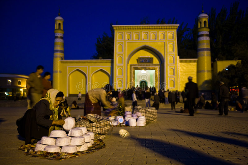 Woman selling skull caps in front of Mosque royalty free stock photos