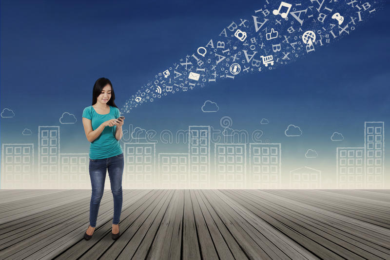 Woman Sending Information With Smartphone Stock Photo