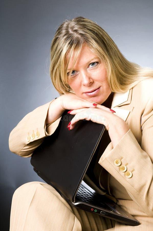 Woman senior business executive. Pretty beautiful middle age blond woman secretary receptionist successful expression senior business executive manager stock photography