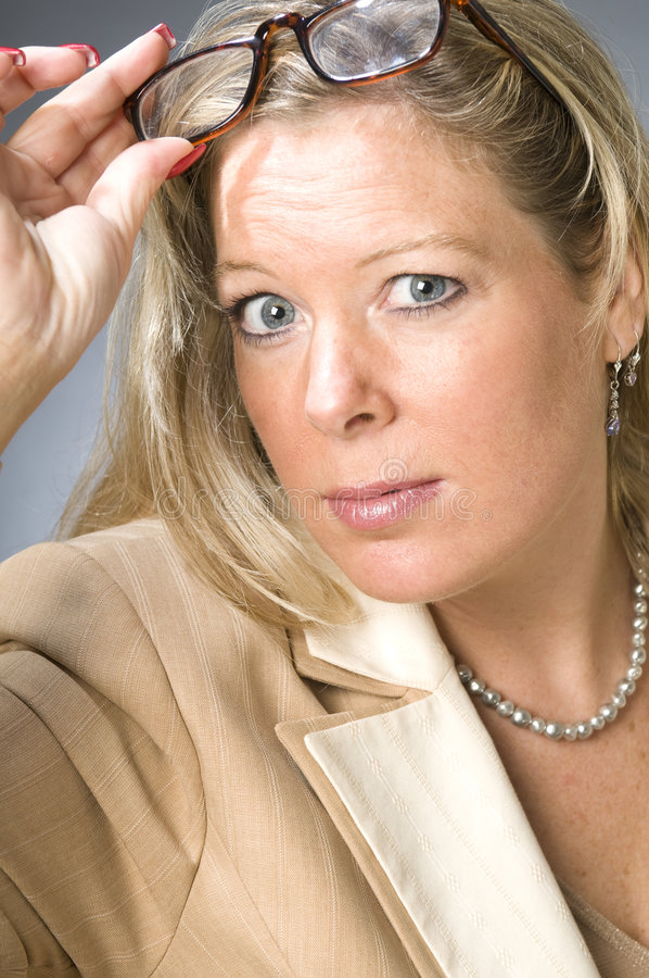 Woman senior business executive. Pretty beautiful young middle age blond woman successful inquisitive expression senior business executive manager corporation stock image