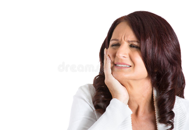 Woman with sensitive tooth ache. Closeup portrait middle aged woman with sensitive tooth ache crown problem crying from pain touching outside mouth isolated royalty free stock photography