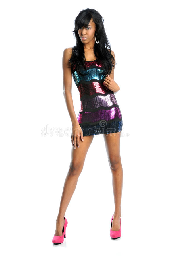 Woman In Sequence Dress. Young African American woman in sequence dress and heels over white background stock photos