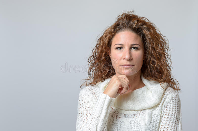 Woman with a serious expression stock photo