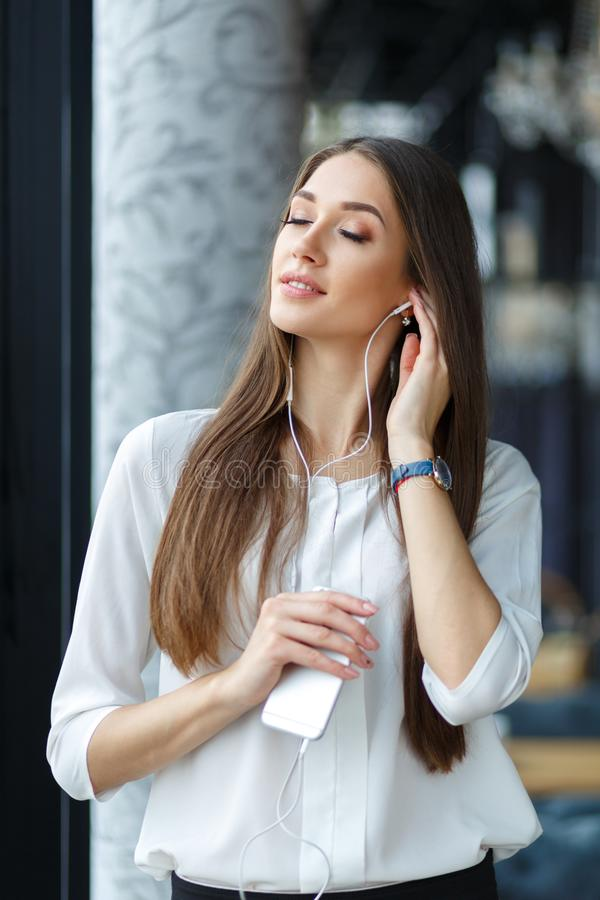 A serious woman is enjoying the music royalty free stock image