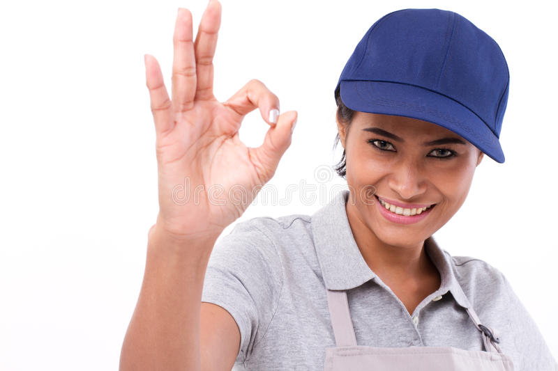 Woman service staff giving ok hand gesture. White isolated background royalty free stock images