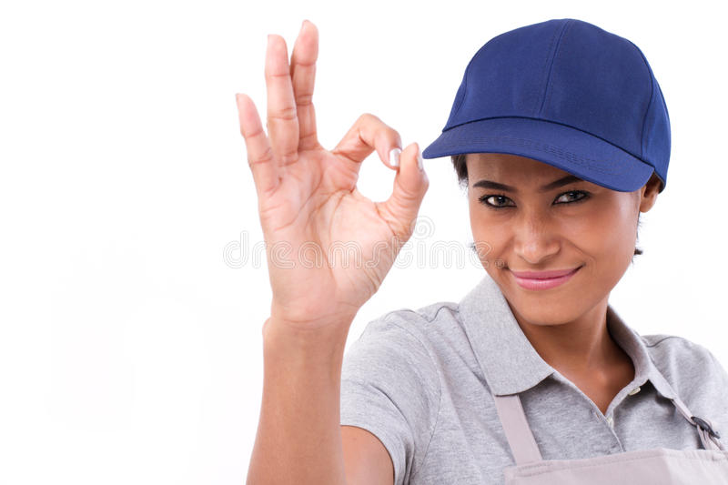 Woman service staff giving ok hand gesture. White isolated background royalty free stock photos