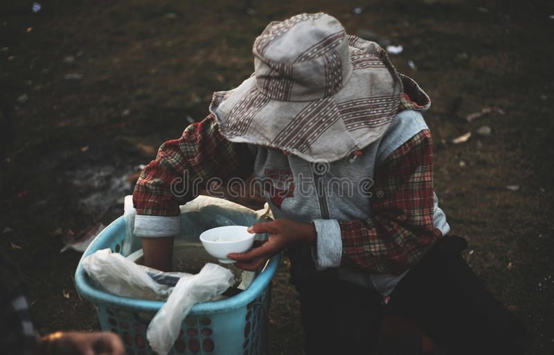 Woman Serving Rice From Tub Free Public Domain Cc0 Image