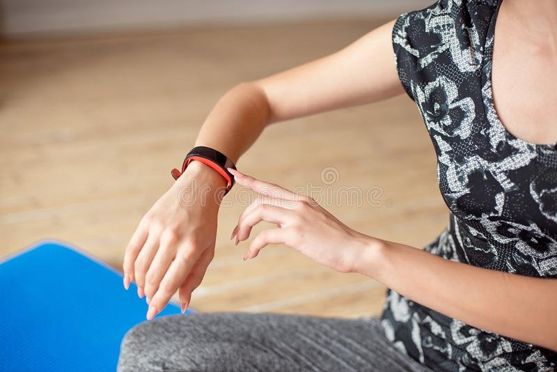 Woman setting up the fitness smart watch for running. Sportswoman checking watch device. Woman setting up the fitness smart watch for running. Sportswoman stock images