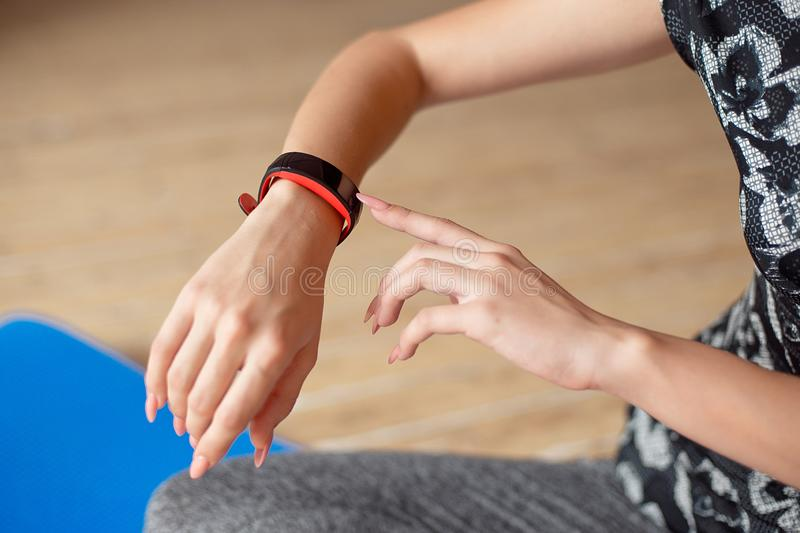 Woman setting up the fitness smart watch for running. Sportswoman checking watch device. Woman setting up the fitness smart watch for running. Sportswoman stock photography