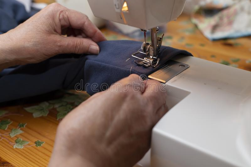 Woman sewing machine royalty free stock photography
