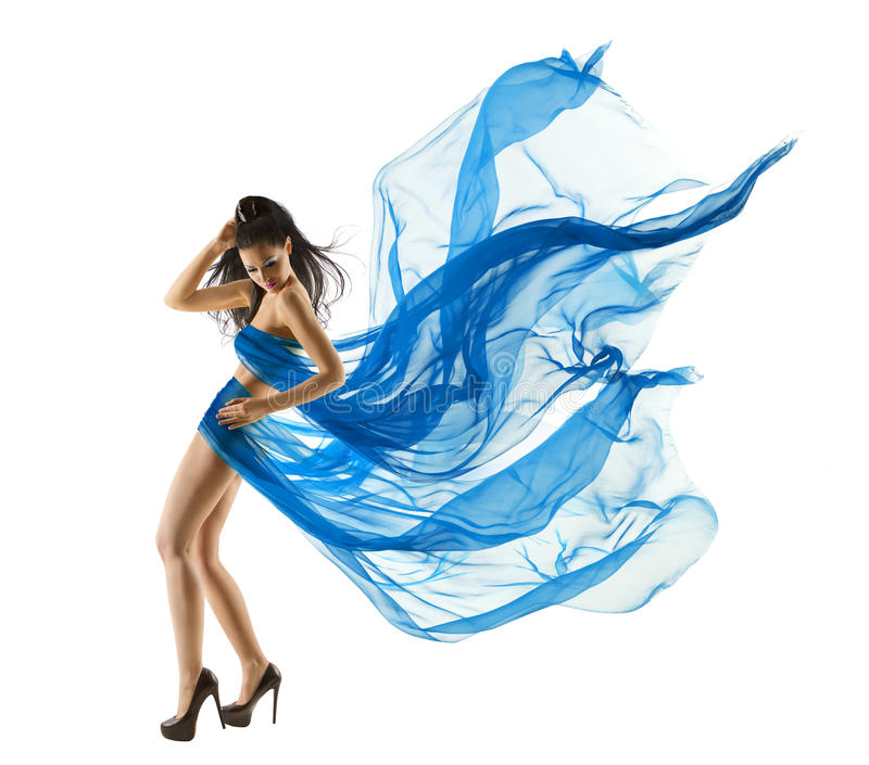 Woman Dancing in Blue Dress. Fashion Model Fluttering Fabric. Woman Dancing in Blue Dress. Fashion Model dance with Waving fluttering Fabric. Long legs. White royalty free stock images