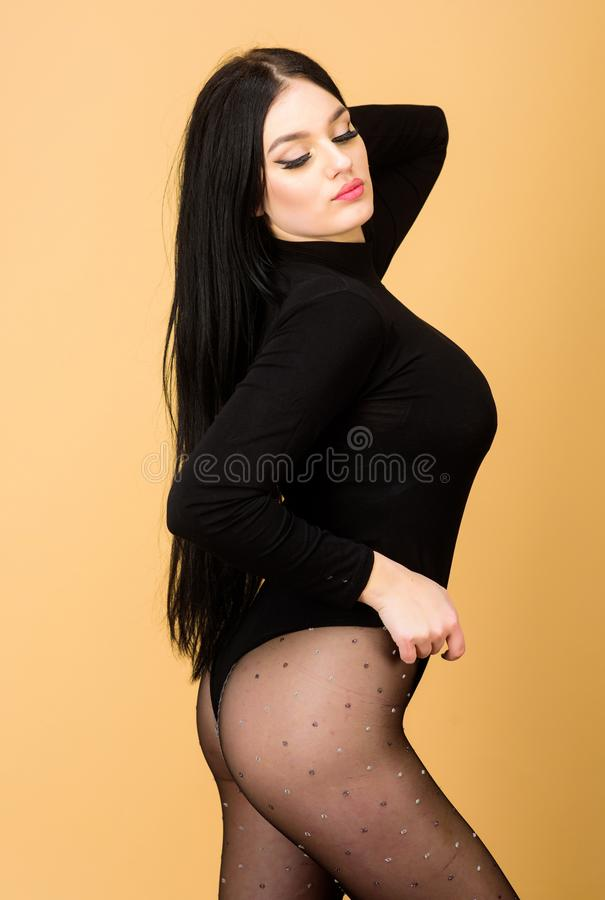 Woman with sexy fit body. underwear fashion. sexy girl in bodysuit and tights. seduction. Fitness and diet. beauty with. Long brunette hair. Add some action to royalty free stock photo