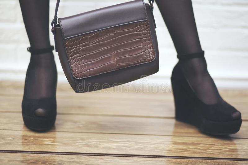 Woman sexy legs with handbag. Shopping and business stock photo