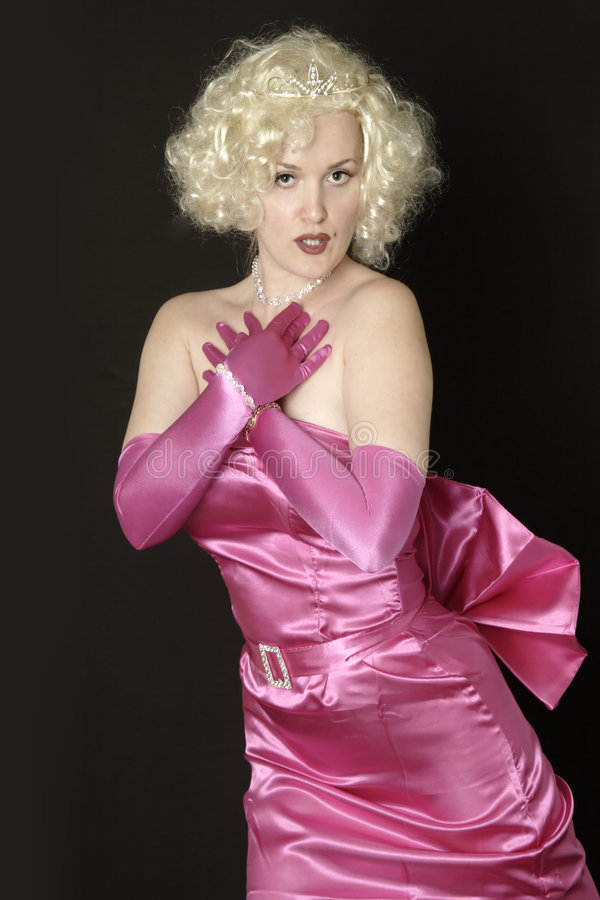 Woman in pink satin gown and gloves royalty free stock photos