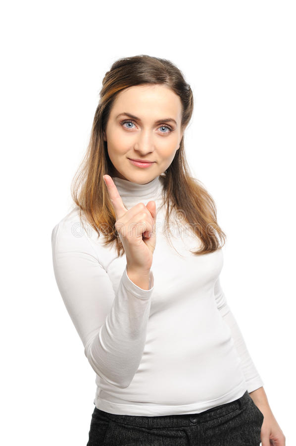 Woman shaking finger. Beautiful young woman stands shaking finger stock photo