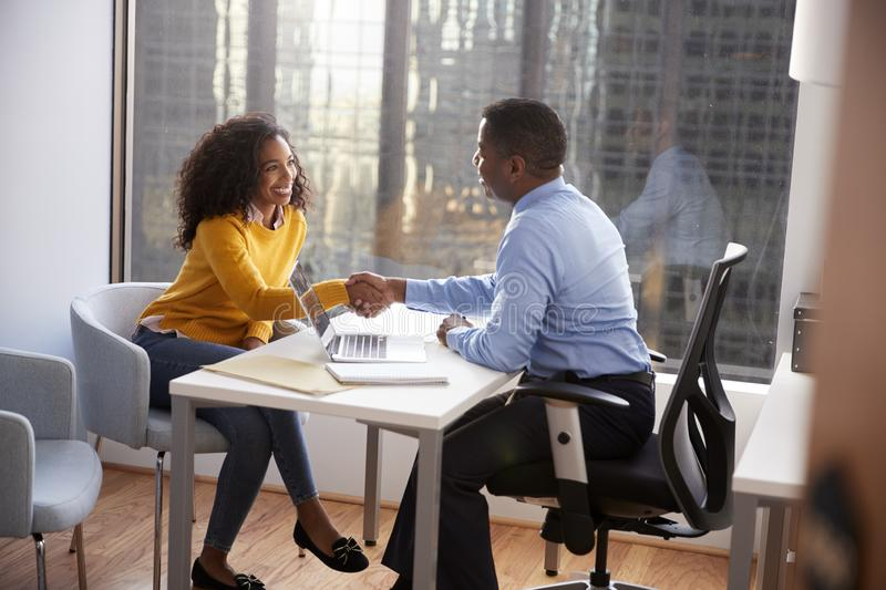 Woman Shaking Hands At Meeting With Male Financial Advisor Relationship Counsellor In Office stock images