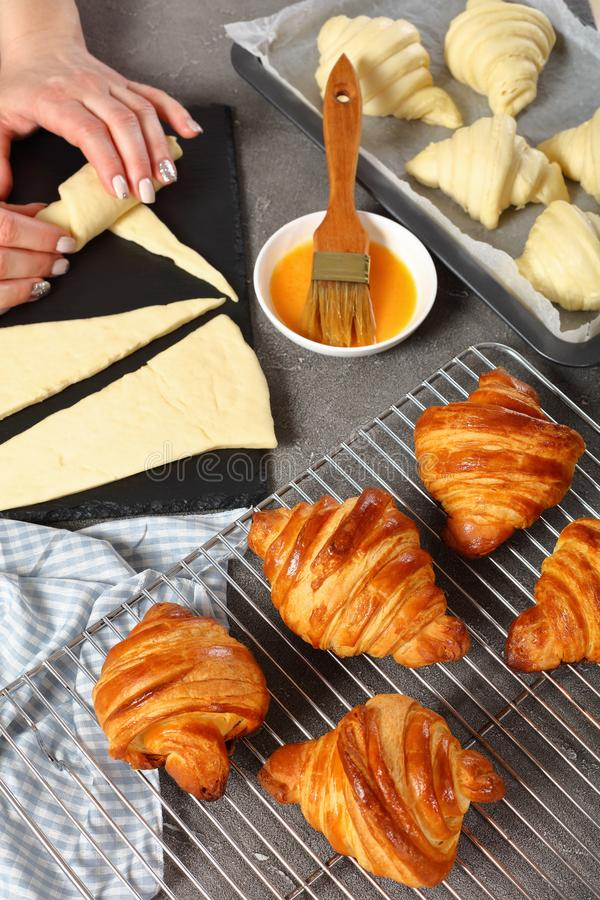 Woman is shaping dough to bake French croissants royalty free stock photos