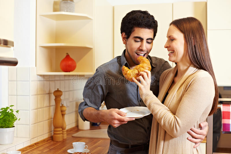Download Woman Sharing Croissant With Man Stock Photo - Image: 18670828